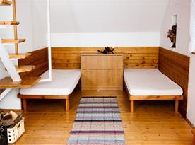 Lůžka v obývacím pokoji