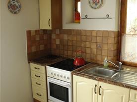 Kuchyně s varnou deskou, troubou