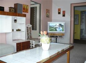 Obývací pokoj v rodinném apartmánu