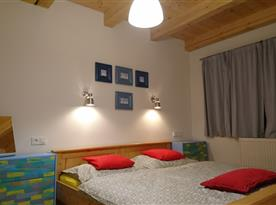 1. NP - manželská ložnice - Apartmán HOME