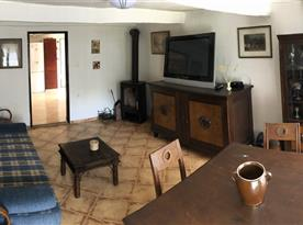 Obývací pokoj s rozkládacím dvojlůžkem