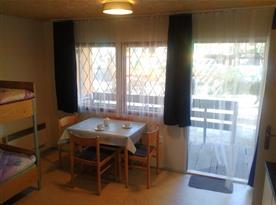 Obytná místnost s kuchyňkou