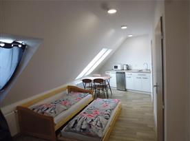 Půdní apartmán s klimatizací.