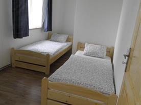 Apartmán A Přízemí - Pokoj s lůžky