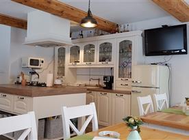 Kuchyně v rámci společenské místnosti