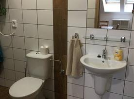 Koupelna v pokojích i apartmánech