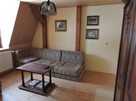 Rozkládací pohovka v obývacím pokoji